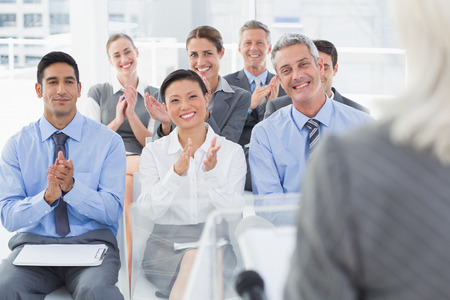 Business people applauding during meeting in office