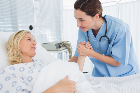 Doctor taking care of patient in hospital room