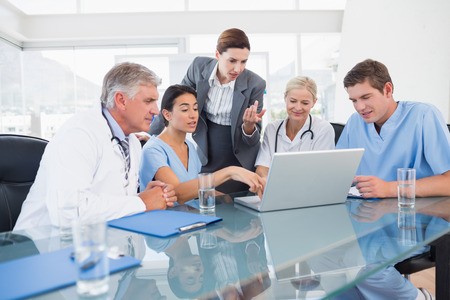 Photo for Team of doctors and businesswoman having a meeting in medical office - Royalty Free Image