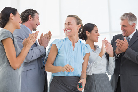 Happy business team smiling at each other in the office