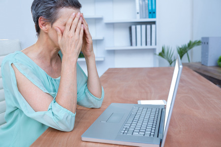 Worried businesswoman in front of her laptop at office