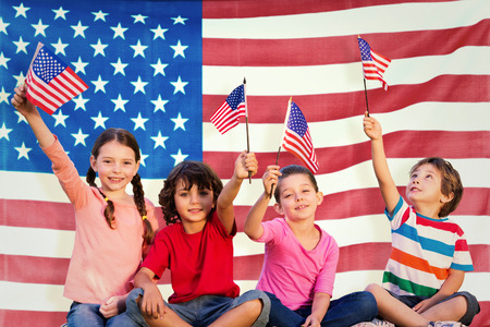 Children with american flags against rippled us flag