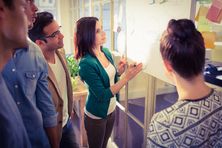 Group of young colleagues in discussion at office