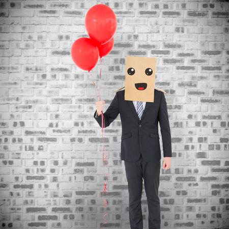 Anonymous businessman against grey brick wall