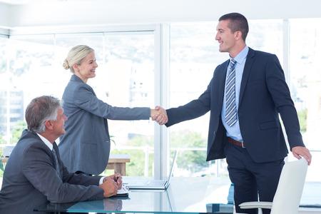 Photo pour Business partners shaking hands in the office - image libre de droit
