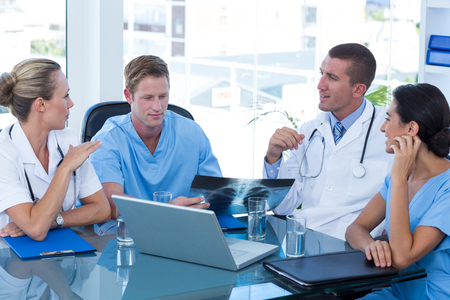 Photo for Team of doctors having a meeting in medical office - Royalty Free Image