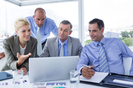 Photo for Business team working together on laptop in the office - Royalty Free Image