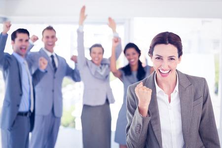 Foto de Business team celebrating a good job in the office - Imagen libre de derechos