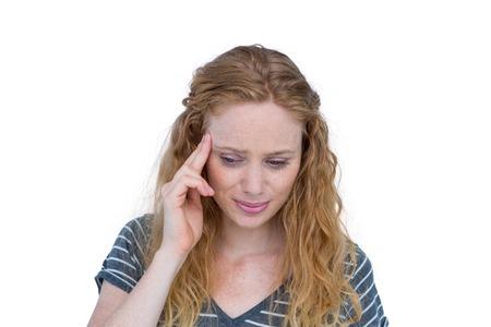 A blonde woman having headache on white background