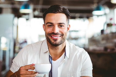 Handsome man having a coffee at the cafe