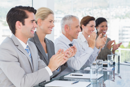 Business team applauding during conference in the office