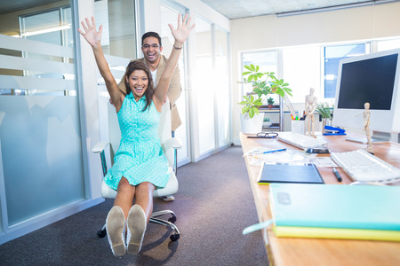 Photo pour Smiling partners having fun in the office - image libre de droit
