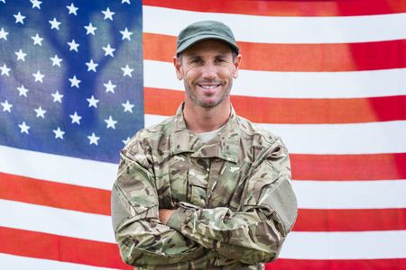 Photo for American soldier holding recruitment sign against american flag - Royalty Free Image