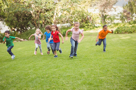 Children running on the grass in a race