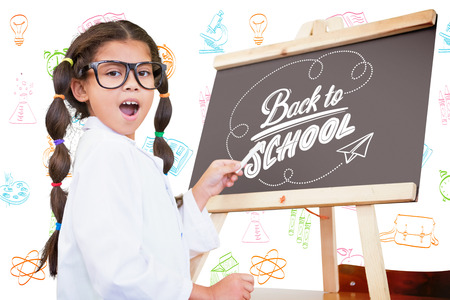 Cute pupil with chalkboard against back to school