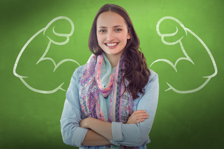 Casual woman against green chalkboard