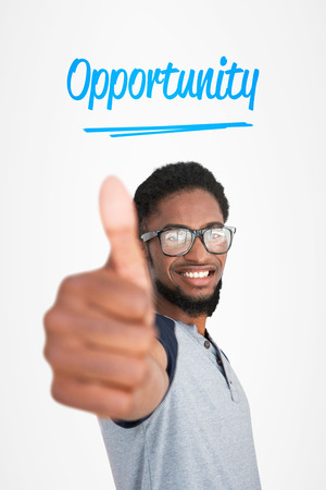 The word opportunity and casual young man gesturing thumbs up against white background with vignette