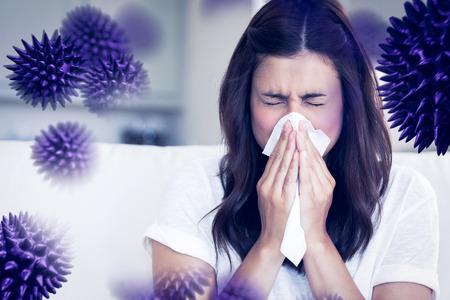 Foto für Brunette sneezing in a tissue against virus - Lizenzfreies Bild