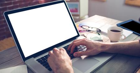 Photo pour Cropped hand of graphic designer using laptop in creative office - image libre de droit