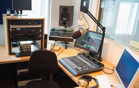 Modern equipment on desk in radio studio
