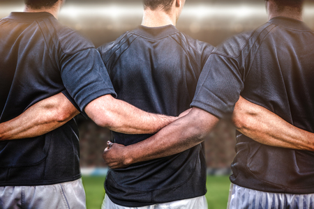 Photo pour Rugby fans in arena against rugby players standing together before match - image libre de droit