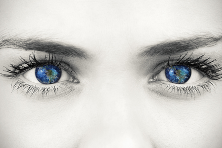 Blue eyes on grey face against earthの写真素材