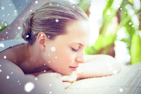 Snow against attractive woman getting massage on her back