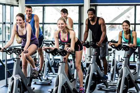 Photo for Fit people working out at spinning class in the gym - Royalty Free Image