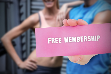 The word free membership and young woman holding blank card against