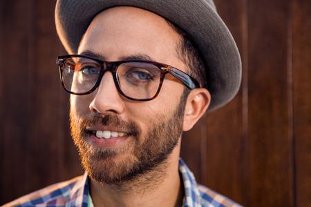 Photo pour Portrait of creative male professional with eye glasses standing against wall - image libre de droit
