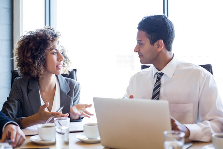 Businesspeople having a discussion in conference room in office