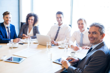 Portrait of businesspeople in conference room during a meeting