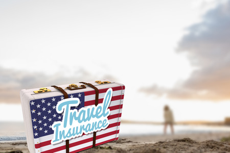 Woman in sweater walking on beach against travel insurance message on an american suitcase