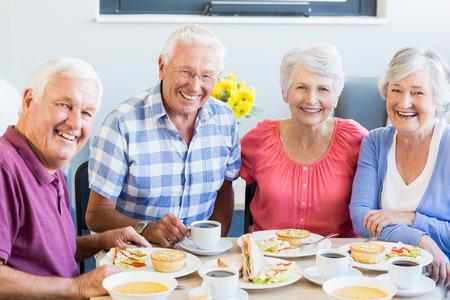 Photo pour Seniors having lunch together in a retirement home - image libre de droit