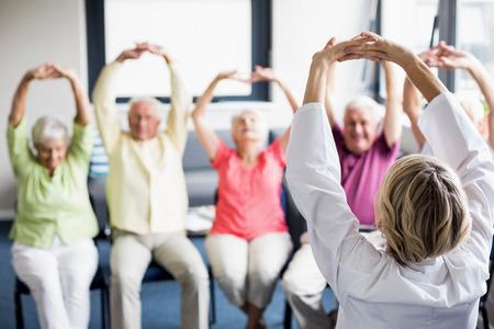 Photo pour Seniors doing exercises in a retirement home - image libre de droit