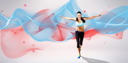 Happy sportswoman is raising arms  against blue wave