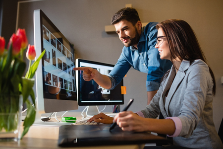 Photo for Graphic designer pointing at computer in office - Royalty Free Image