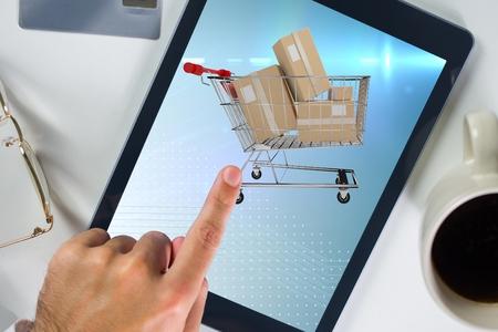 Photo pour Composite image of hand touching a screen of tablet computer for e commerce - image libre de droit
