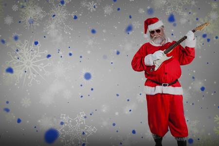 Smiling Santa Claus playing guitar against snowflake pattern