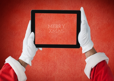 Close-up of hands of santa claus holding a digital tablet with text marry xmass