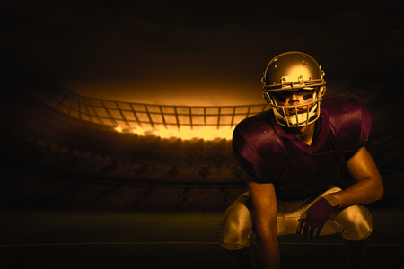3D American football player in uniform crouching against rugby stadium