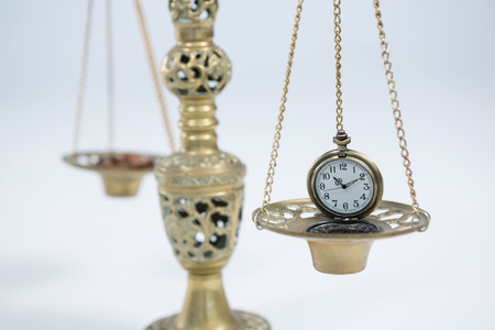 Close-up of pocket watch on weight scale