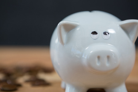 Close-up of piggy bank on wooden table