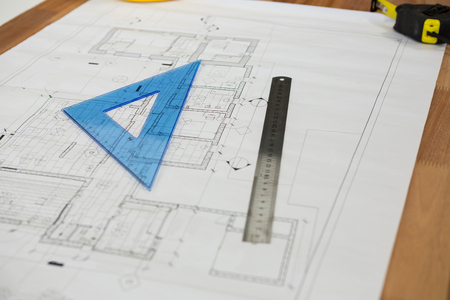 Close-up of blueprint with ruler on table