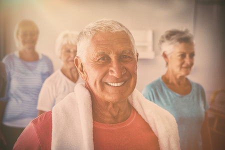 Portrait of senior smiling after exercises in retirement house