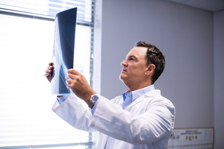 Male doctor examining x-ray in clinic