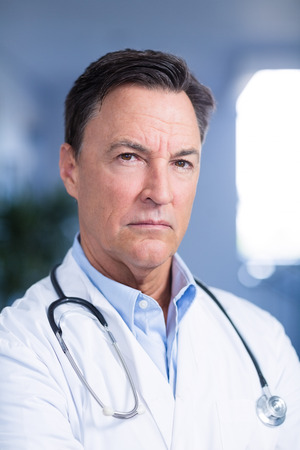 Portrait of confident doctor with stethoscope in hospital