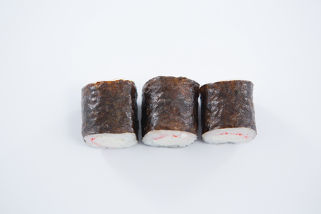Close-up of maki sushi on white background