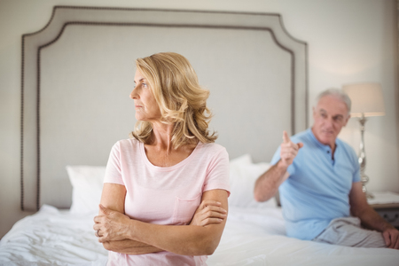 Couple having an argument in bedroom at home