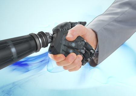 Business man shaking hands with robot against blue backgroundの写真素材